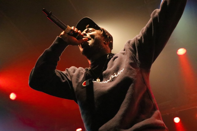 A rapper performing on stage.
