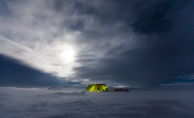 A tent in the middle of nowhere of icy Norway - there is now all over the place plus it looks dark and windy.