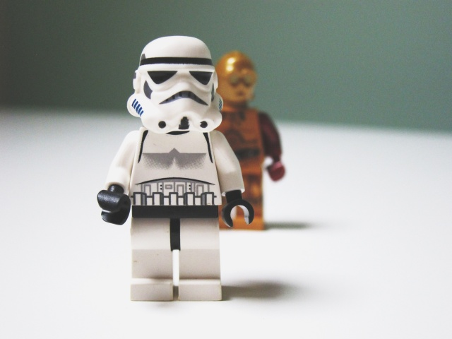 Big LEGO stormtrooper in the foreground and small C3PO figure in the back.