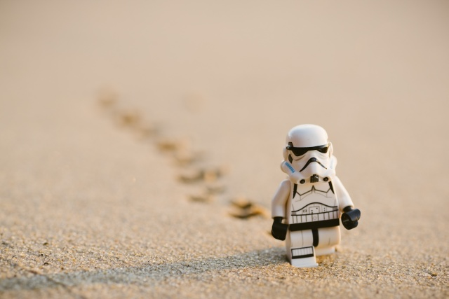 Stormtrooper walking a while in the sand.