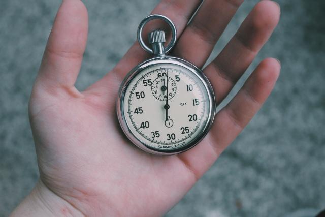 A hand holding a classic Soviet Union era (CCCP) stop watch.
