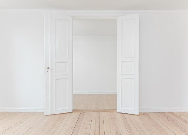 Open doors inside a newly renovated flat.