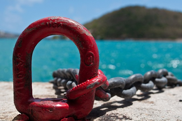 A heavy chain to tuck your boat at a pier on a sunny day