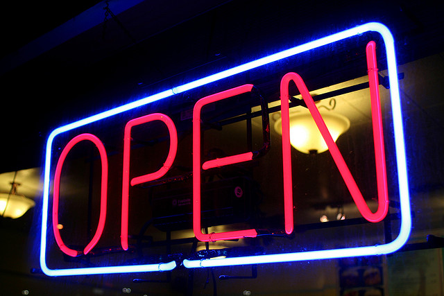 A large neon sign saying 'open