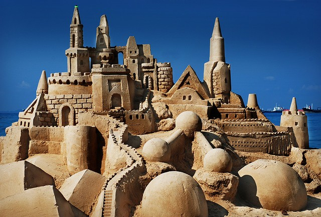 A humongous sandcastle with numerous buildings that look very realistic. An incredible work. Truly impressive.