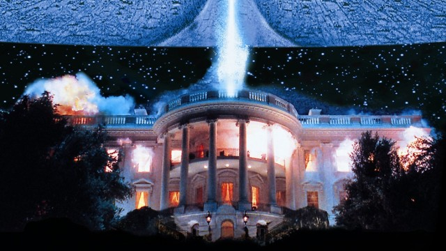 Scene from the Independence Day movie: an alien space ship is destroying the White House with a laser beam weapon.