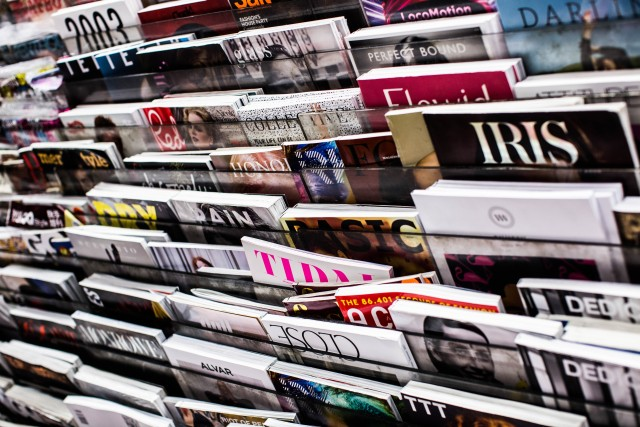 A huge newsstand selling literally dozens if not hundreds of fashion magazines.