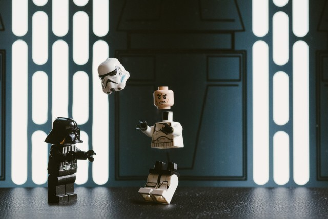LEGO Darth Vader kills a storm trooper by applying the force.