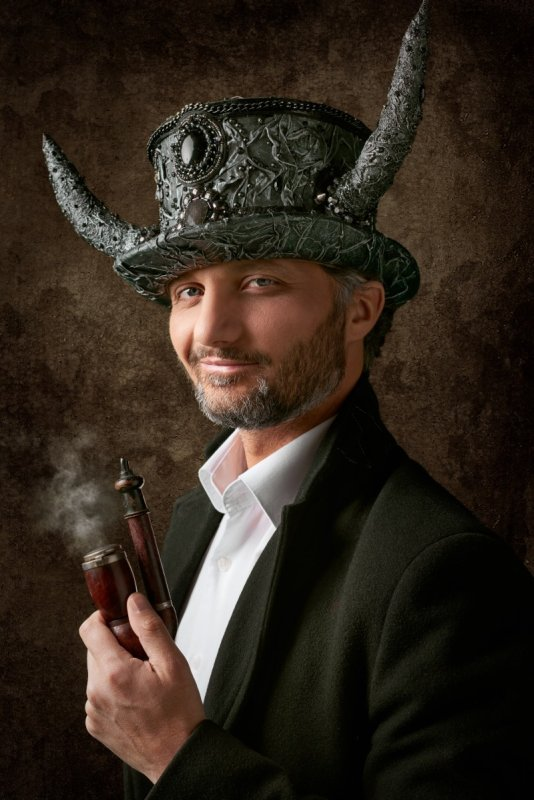 Man wearing steampunk hat with horns